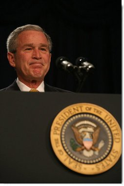 President George W. Bush acknowledges the applause as he attends the 56th National Prayer Breakfast Thursday, Feb. 8, 2008, at the Washington Hilton Hotel. Said the President,