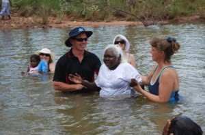 Pastors Bruce and Terri Connell baptising Lucy in an outback (Kimberleys) pool)