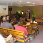 Pastor Daniel preaching at church on Gold Coast where woman was healed of cancer