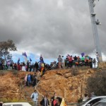 Rain clouds gather as Christians pray on Mount Ainslie
