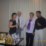 Pastor Daniel and Office Manager Dianne presenting appreciation gifts