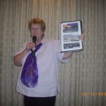 Dianne holding very special appreciation book from CTFM family to Pastor Daniel