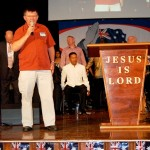 Pastor Barry Smith from AOG praying for families