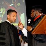 Dr Jackson prophesying over Pastor Daniel