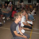 Young and old on their knees surrendering to Jesus