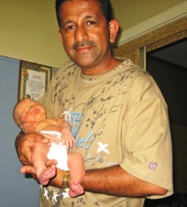 Pastor Daniel and baby saved through Options Plus Care Pregnancy Counseling
