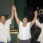 Young woman set free from demonic spirits and rejoicing with her father and Ps Daniel