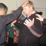 Ps Daniel prays over Four Square Gospel Pastor