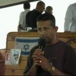 Ps Daniel preaching sermon on Sea of Galilee boat ride