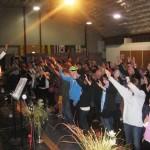Ps Daniel praying as youth surrender to Jesus at altar