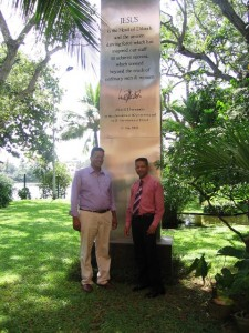 Ps Daniel with Dilma tea company owner\'s son at tower they erected to honour Jesus