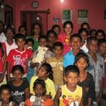 Pr Daniel's daughter Shannen with children at orphanage