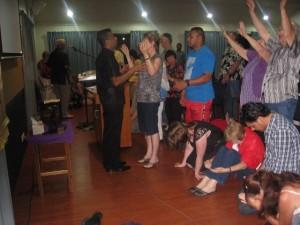 Pr Daniel praying with people