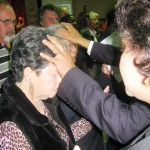 Pr Daniel and his wife Maryse pray for credentialed minister and spouse