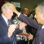 Pr Daniel praying for credentialed minister