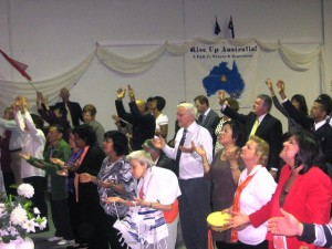 Some of the congregation worshipping at the altar
