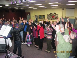 People surrendering to Jesus at altar with Pr Daniel