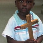 Sudanese boy holding a Cross