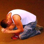 Young man mightily touched by Lord and weeping at altar