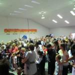 Pr Daniel praying for children with parents