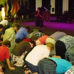 Christians repenting on their knees on behalf of Church and Nation