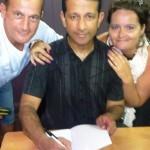 Couple gets Pr Daniel to autograph his book'