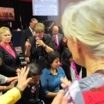 CTFM leadership praying over Pr Daniel, wife Maryse and family