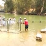 Pr Daniel baptising around 50 people in Jordan people