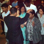 Ministering at altar at combined churches revival meeting in Toronto, Canada