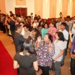 Ministering at altar call at combined churches revival meeting in Toronto, Canada