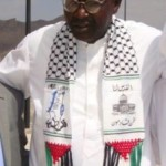 Obama's Brother Wears Terrorist Scarf Calling for the Destruction of Israel