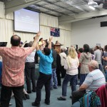 Some of the hungry crowd worshipping Jesus at the altar